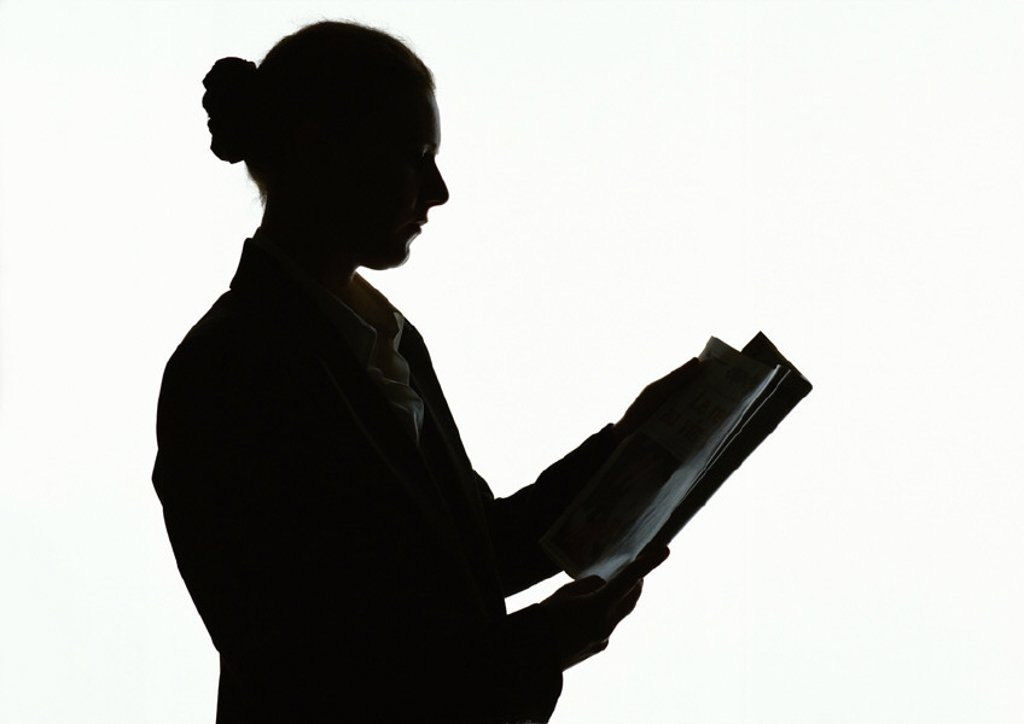 Woman reading, silhouette : Stock Photo