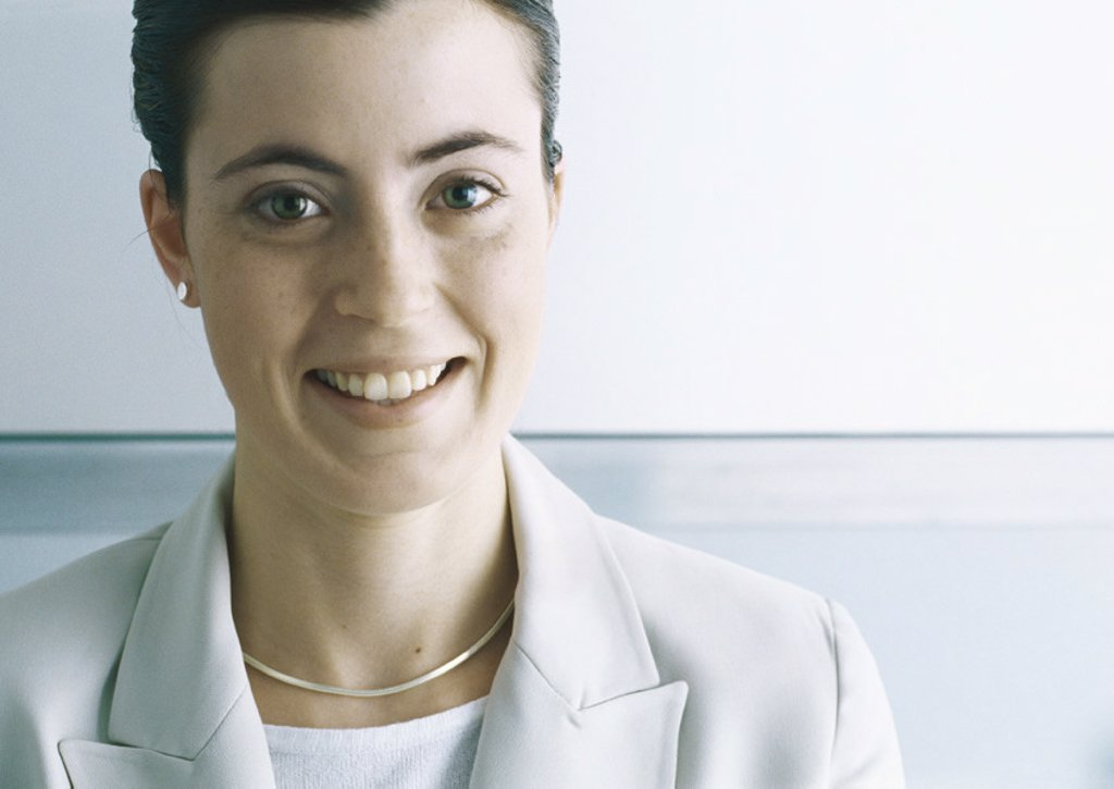 Stock Photo: 1569R-270010 Businesswoman smiling at camera, close-up
