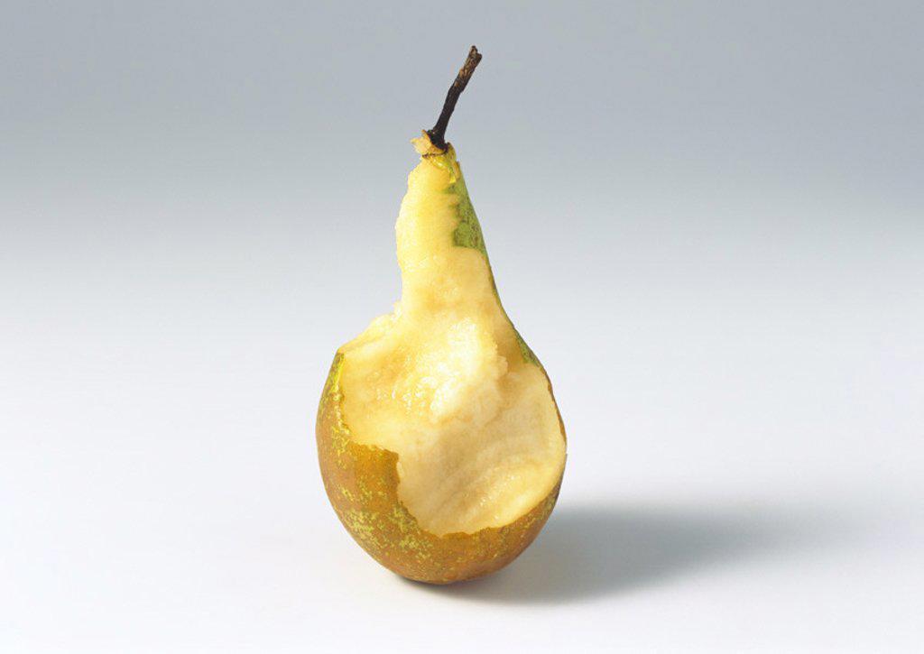 Half-eaten pear : Stock Photo