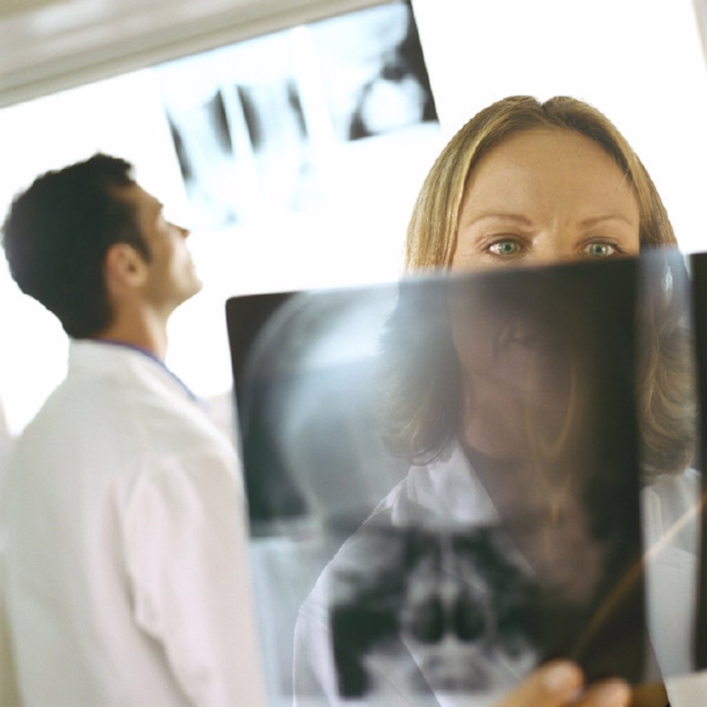 Doctors in x-ray lab : Stock Photo