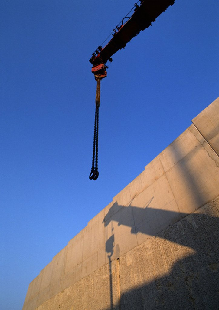 Stock Photo: 1569R-31084 Crane and shadow on wall, low angle view
