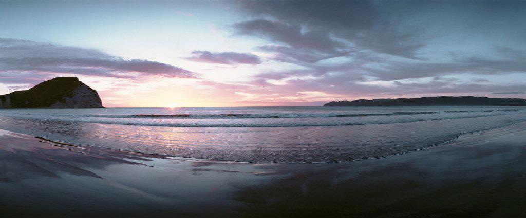 Stock Photo: 1569R-33024 New Zealand, beach at sunset, panoramic view