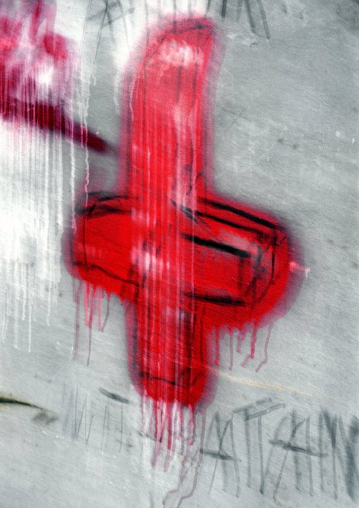 Stock Photo: 1569R-34021 Cross painted on wall, blurred