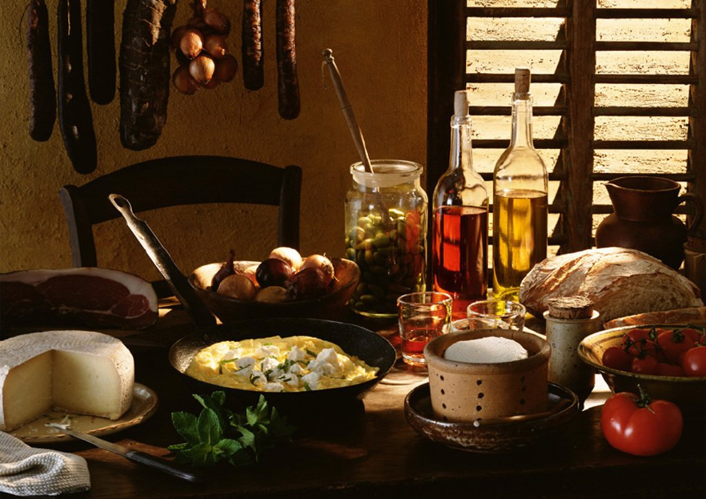 Table spread with various foods and cooking ingredients : Stock Photo