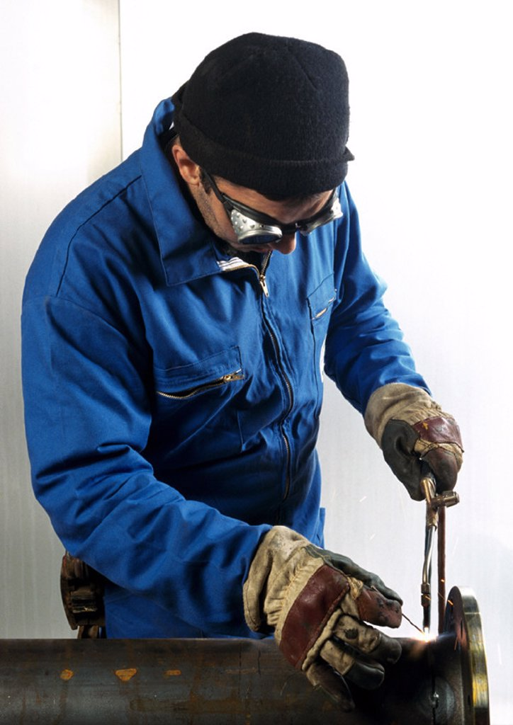 Stock Photo: 1569R-39096 Man using welding torch