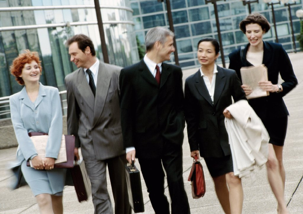 Group of business people walking side by side : Stock Photo