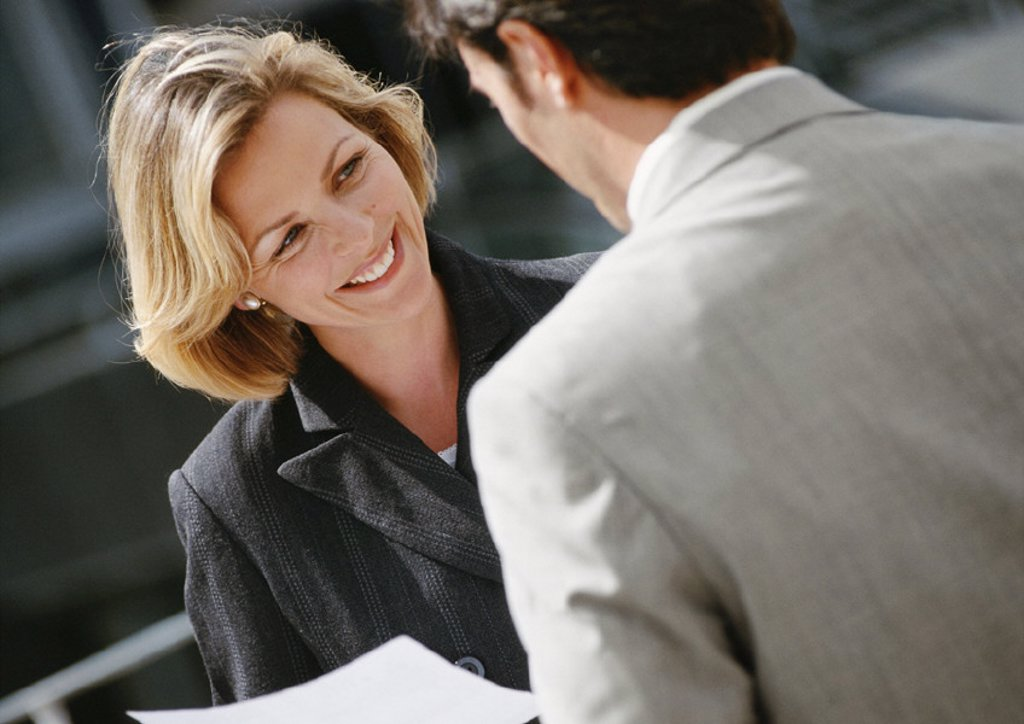 Stock Photo: 1569R-43063 Businessman and businesswoman face to face, close-up