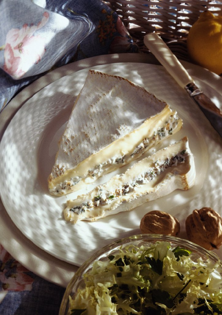 Stuffed brie on plate, high angle view : Stock Photo