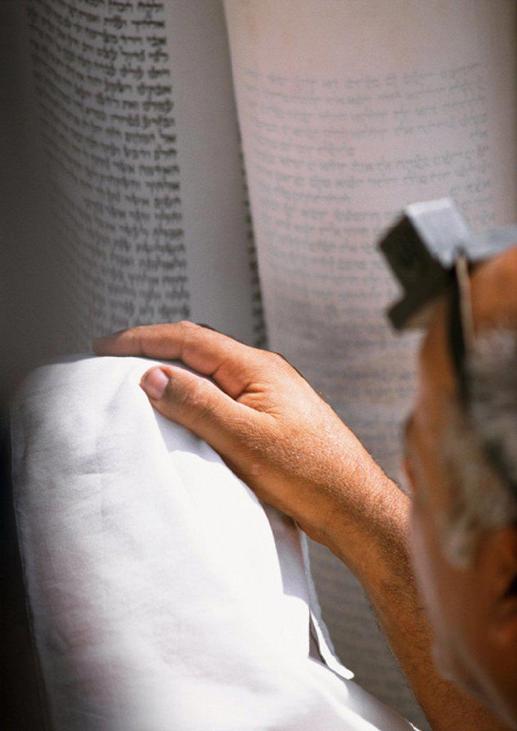 Hand, Torah in background : Stock Photo