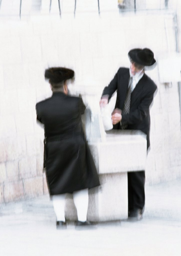Israel, Jerusalem, two Orthodox Jews, blurred : Stock Photo