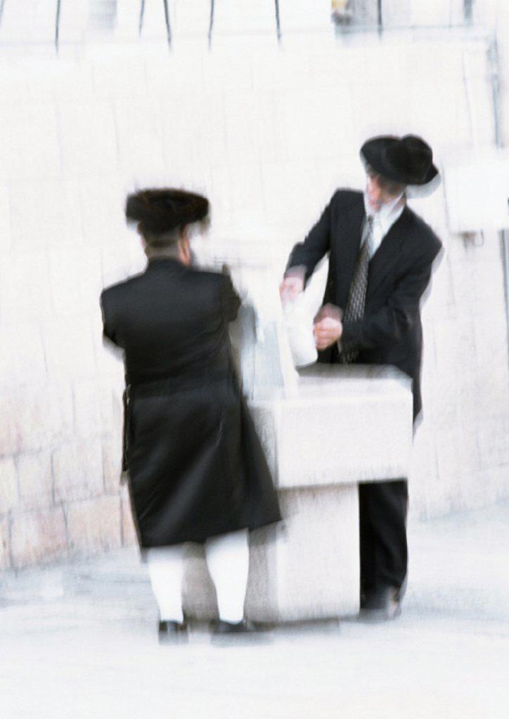 Stock Photo: 1569R-52041 Israel, Jerusalem, two Orthodox Jews, blurred