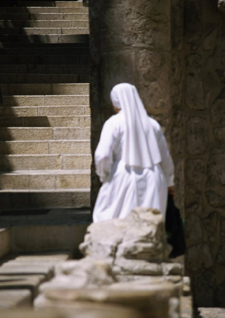 Stock Photo: 1569R-52050 Israel, Jerusalem, nun by stairs, rear view