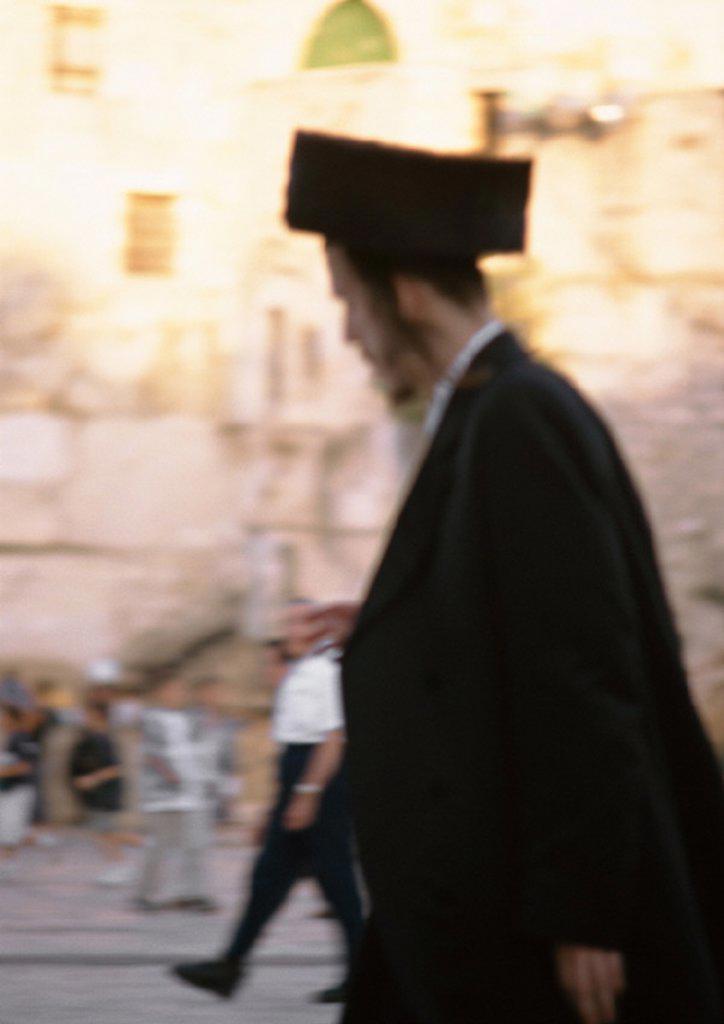 Israel, Jerusalem, Orthodox Jew, side view, blurred : Stock Photo