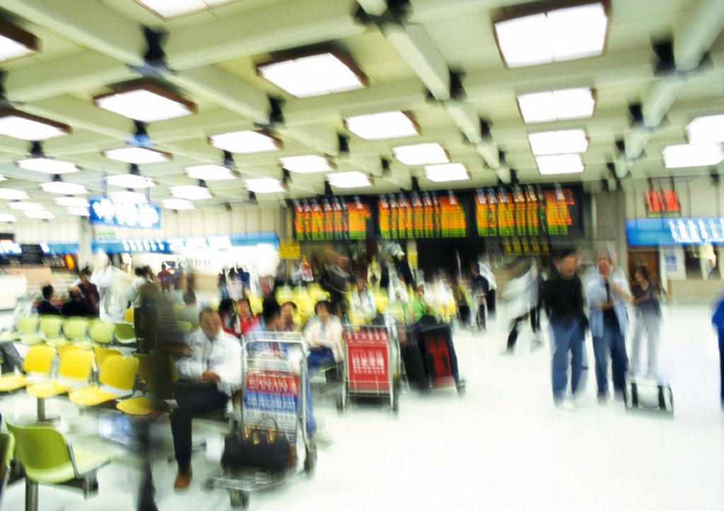 Stock Photo: 1569R-55004 People in airport terminal, blurred