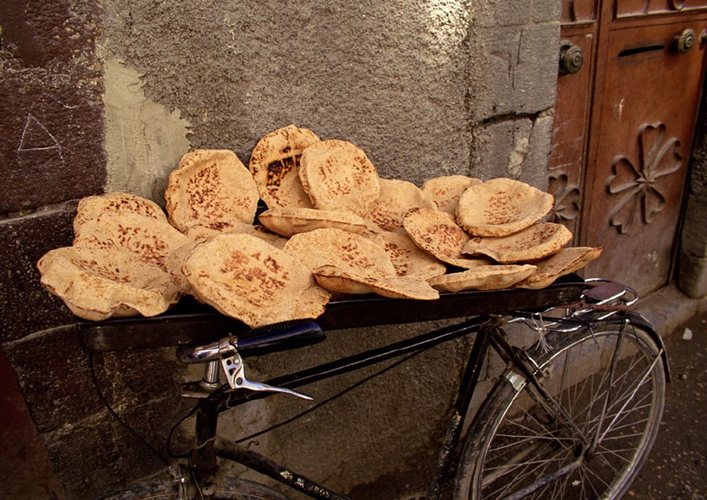 Syria, pita bread being sold, placed on bicycle : Stock Photo