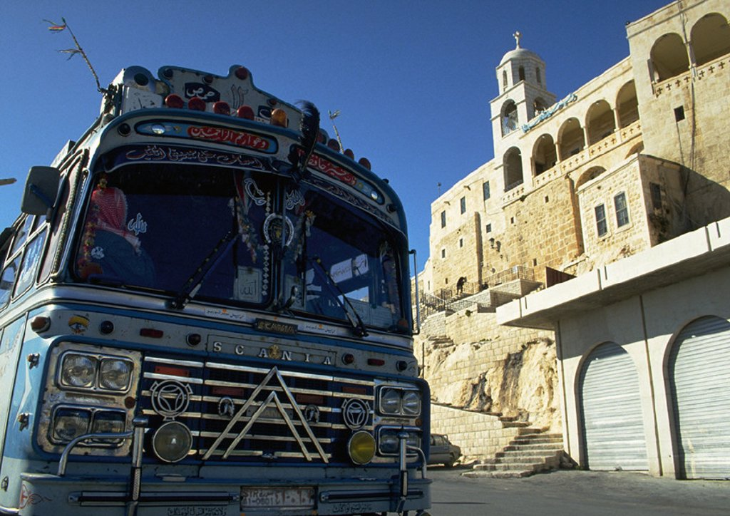 Stock Photo: 1569R-6069 Syria, front of blue bus and ancient building