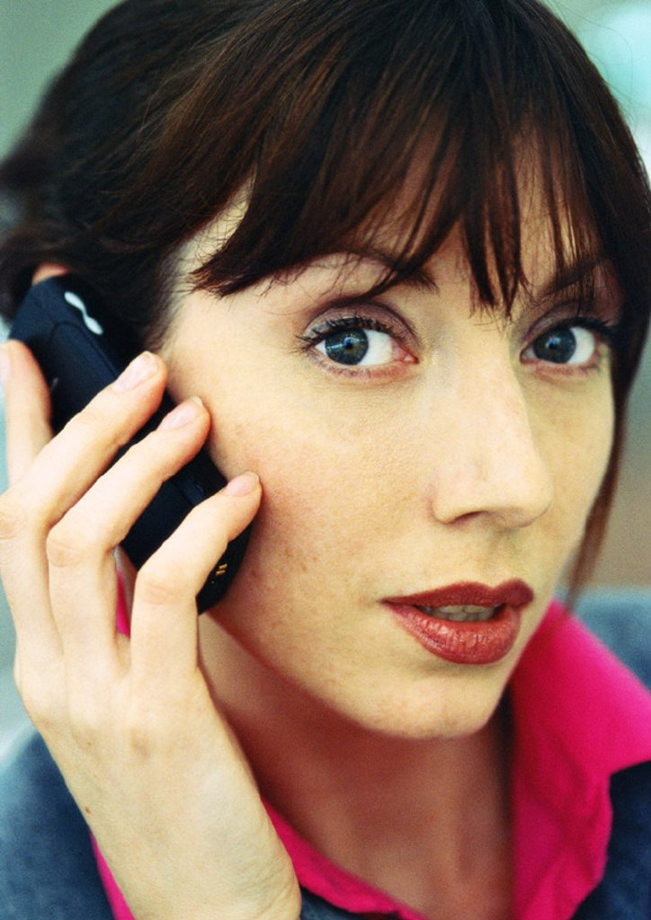 Businesswoman using cellular phone, close-up, portrait : Stock Photo
