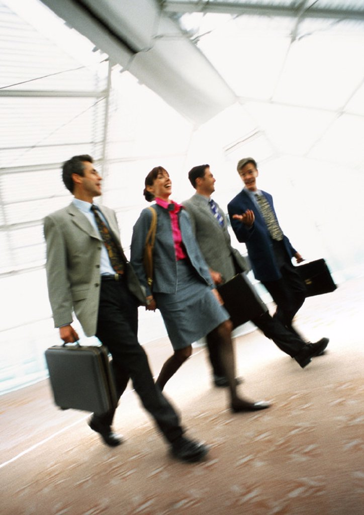 Group of business people walking together indoors, blurred : Stock Photo