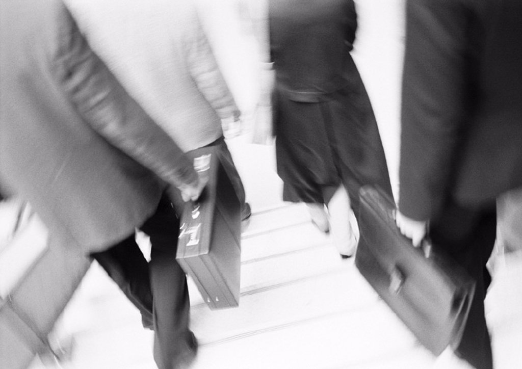 Stock Photo: 1569R-71073 Business people walking down steps, lower section, blurred, b&w
