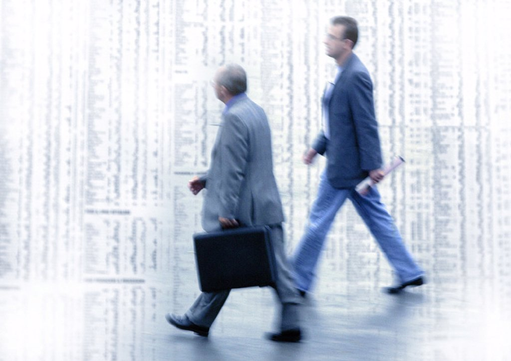 Stock Photo: 1569R-77040 Two men walking on stock quotes, montage
