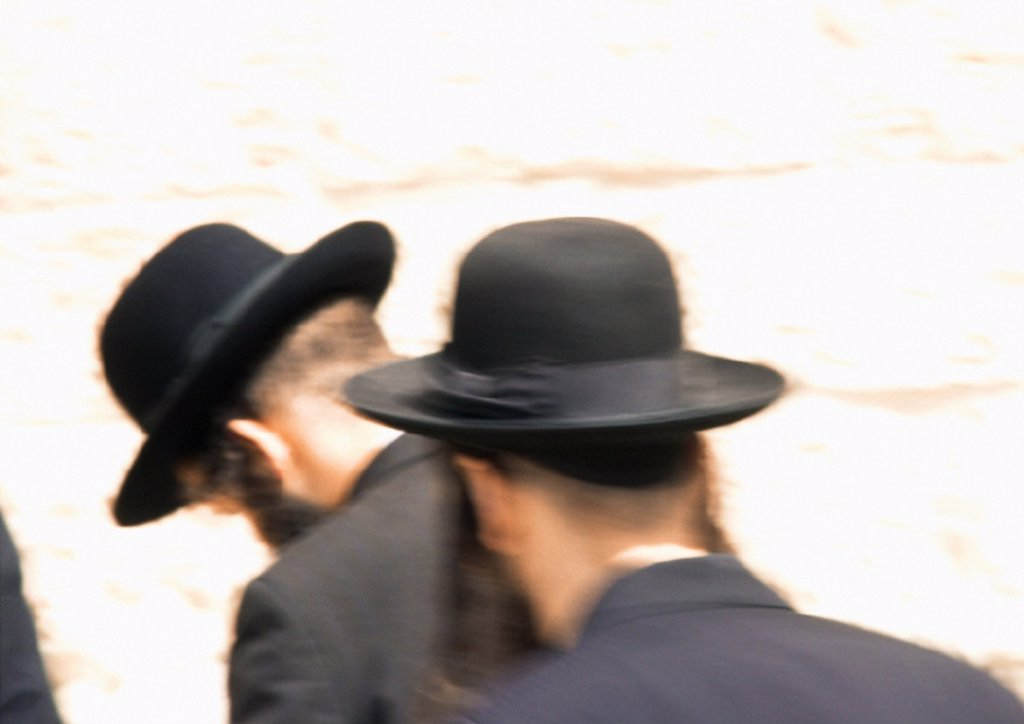 Israel, Jerusalem, Orthodox Jewish men praying at Wailing Wall, rear view, blurred : Stock Photo