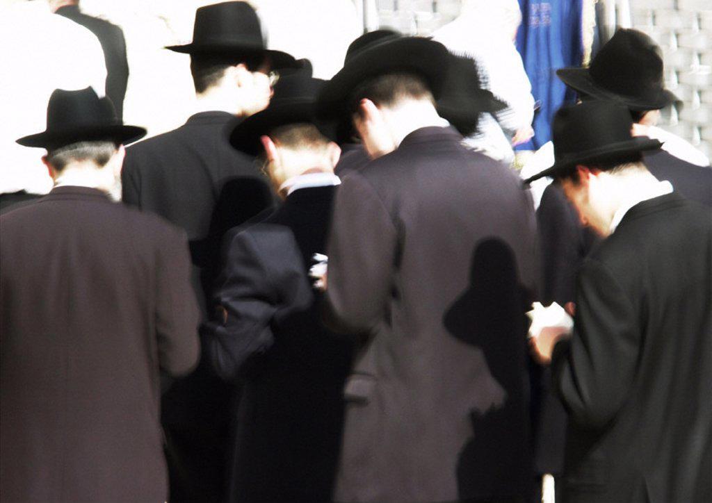Israel, Jerusalem, Orhtodox Jewish men praying at the Wailing Wall : Stock Photo