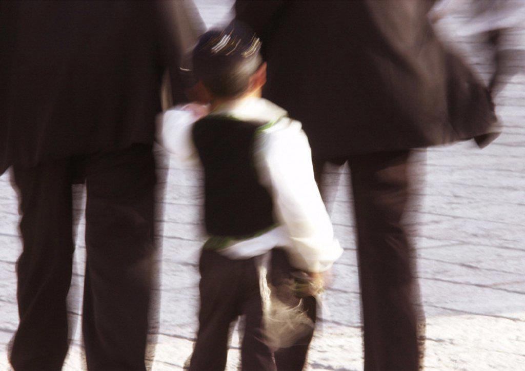 Israel, Jerusalem, close up of little Jewish boy walking, rear view, blurry : Stock Photo