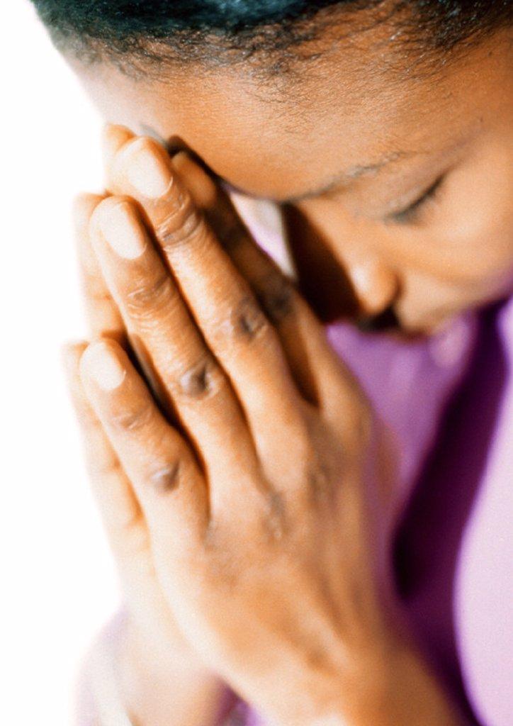 Stock Photo: 1569R-83046 Woman with eyes closed, praying, close-up