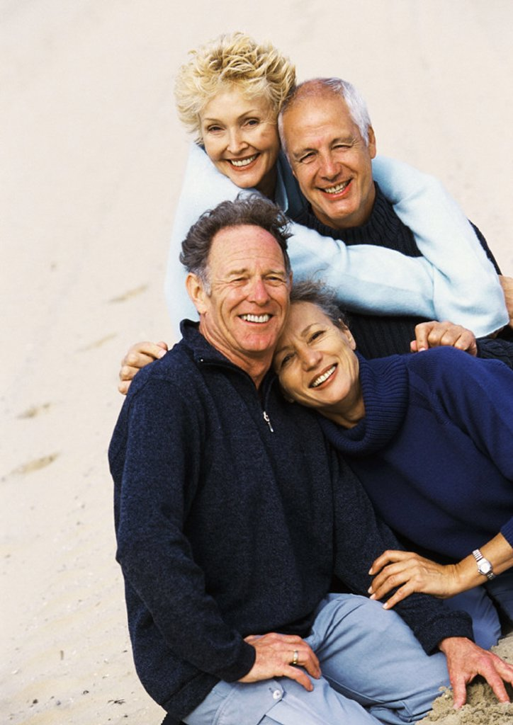 Mature couples on the beach, portrait : Stock Photo