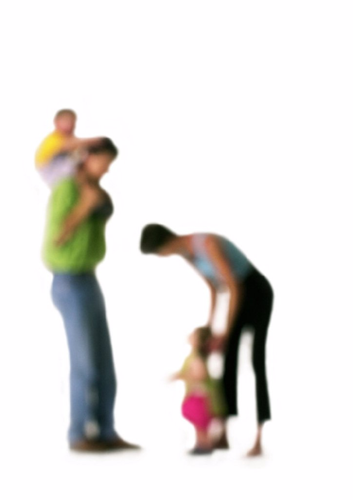 Silhouette of parents with two children, on white background, defocused : Stock Photo