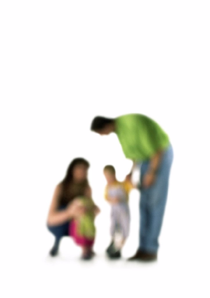 Stock Photo: 1569R-88079 Silhouette of parents speaking to two children, on white background, defocused