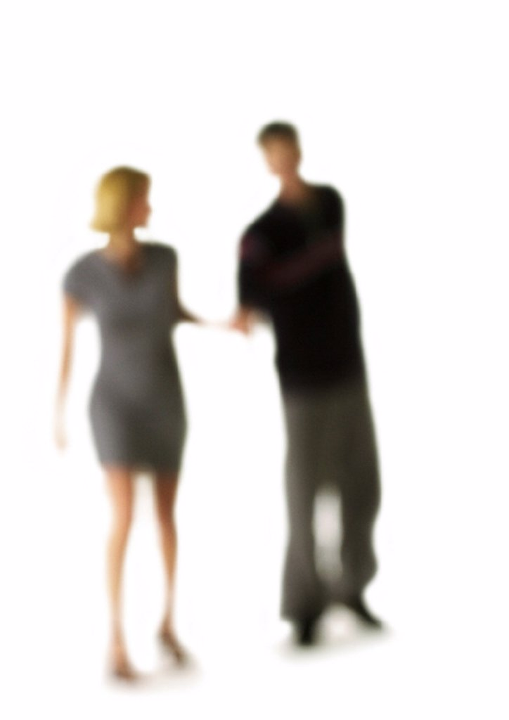 Stock Photo: 1569R-88084 Silhouette of couple, on white background, defocused