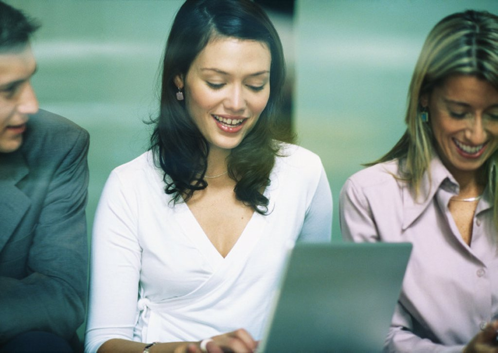 Stock Photo: 1569R-9010080 Three businesspeople side by side