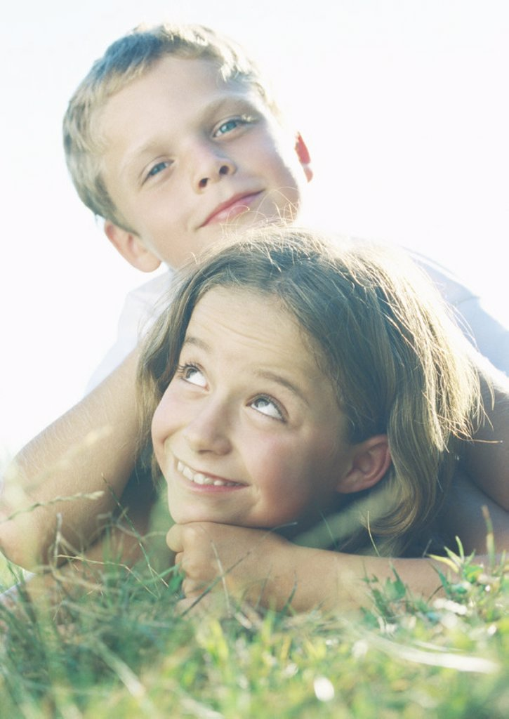 Stock Photo: 1569R-9010211 Boy and girl lying in grass