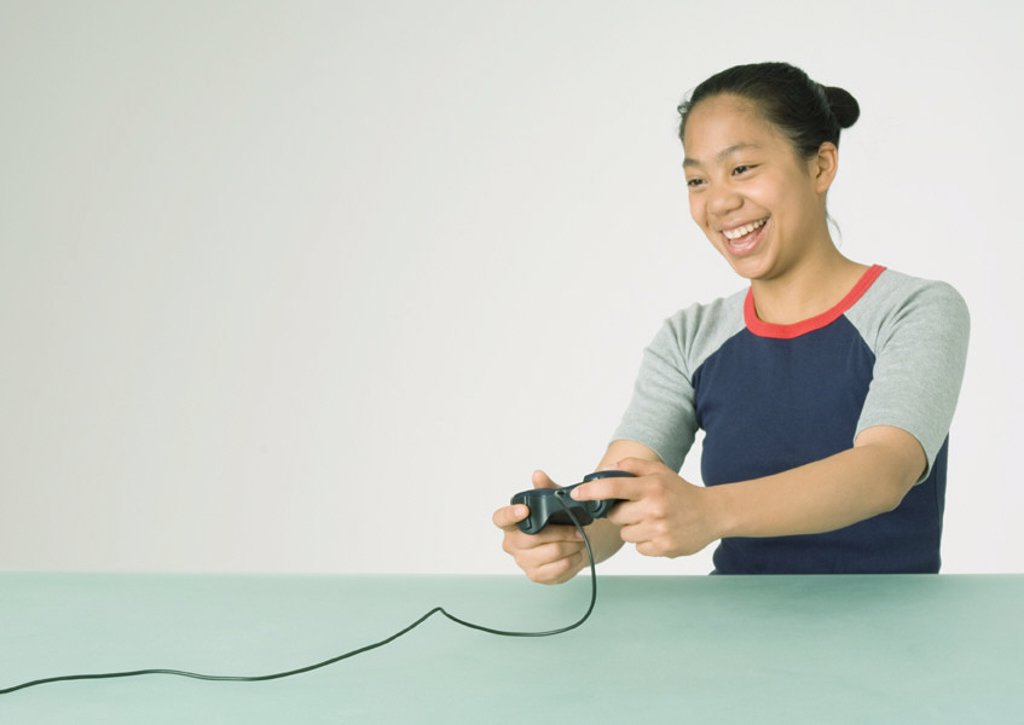 Young woman playing video game : Stock Photo