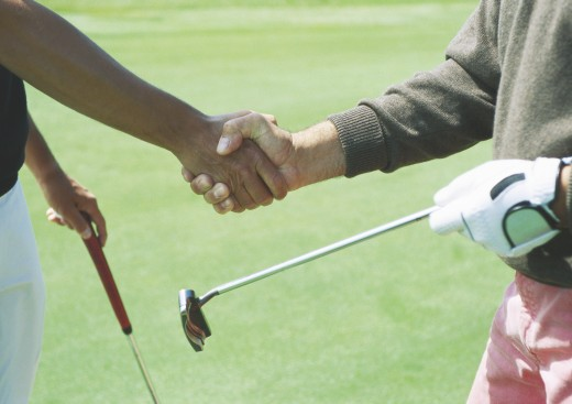Stock Photo: 1569R-9011364 Golfers shaking hands