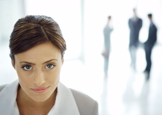 Businesswoman in office lobby, portrait : Stock Photo