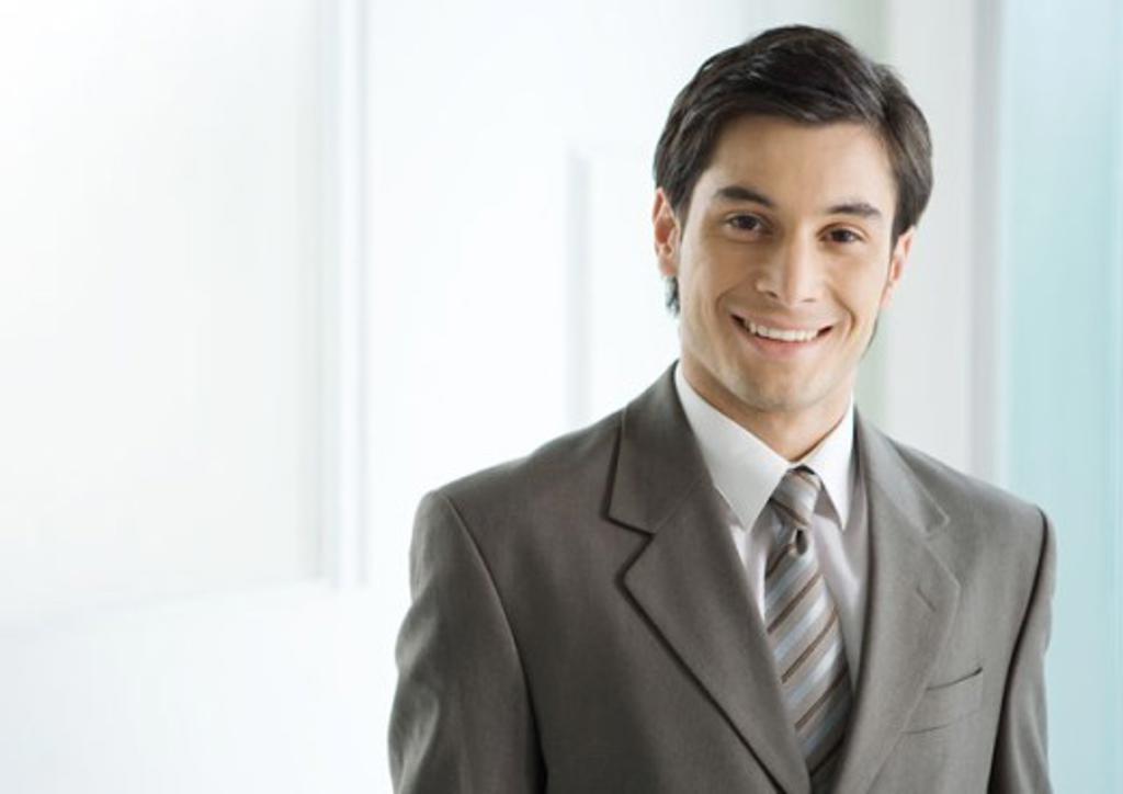 Stock Photo: 1569R-9011615 Businessman smiling, portrait
