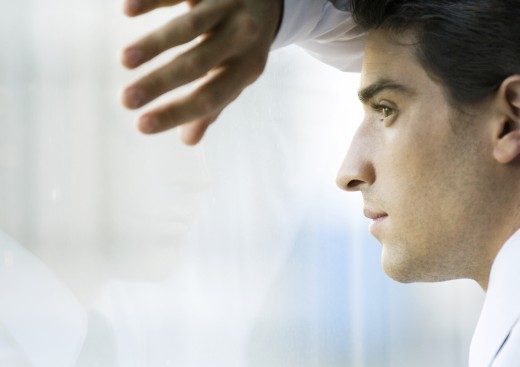 Stock Photo: 1569R-9011739 Man looking through window