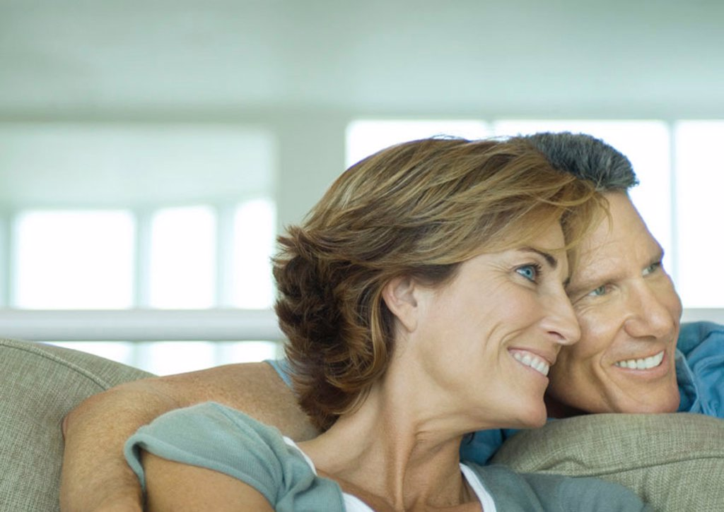 Stock Photo: 1569R-9013016 Mature couple smiling, cheek to cheek
