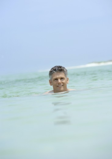 Man swimming in sea : Stock Photo