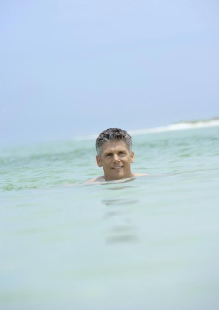 Stock Photo: 1569R-9014617 Man swimming in sea