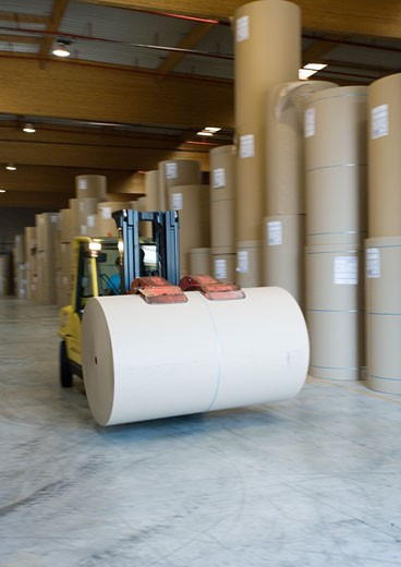 Stock Photo: 1569R-9015106 Fork lift carrying roll of paper