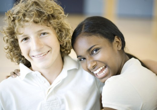 Teenage boy and girl, laughing : Stock Photo