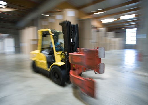 Forklift in paper mill : Stock Photo