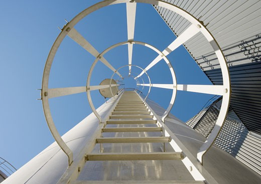 Safety ladder in industrial area, view from directly underneath : Stock Photo