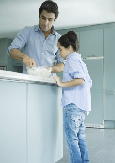 Stock Photo: 1569R-9017341 Father and daughter cooking together