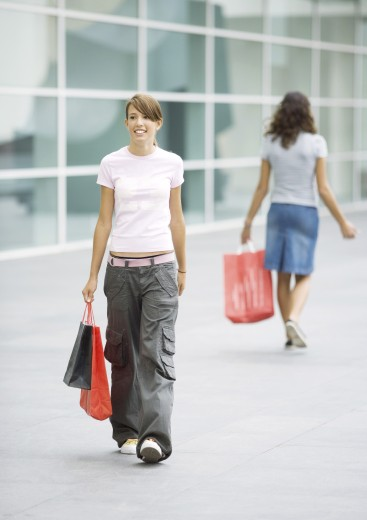 Stock Photo: 1569R-9017546 Teen girls carrying shopping bags