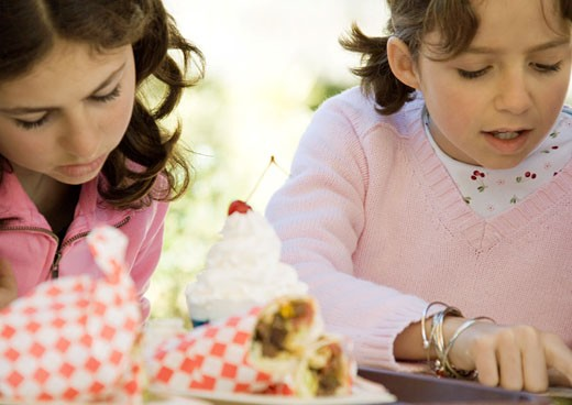Two girls with fast food : Stock Photo