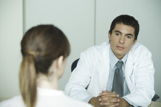 Stock Photo: 1569R-9019003 Doctor sitting across from female patient